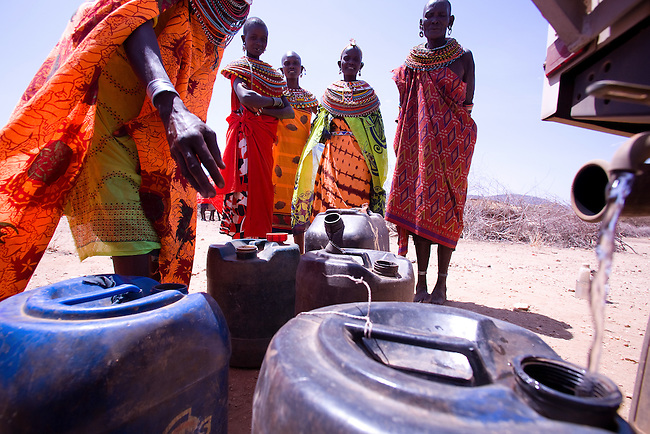 Samburu women in northern Kenya village of Kiltamany wait in line to fill their jerry cans from a drought relief vehicle. The worst drought (2008-2009) in more than a decade has killed most of their livestock and threatens their own survival.