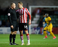 Referee Graham Salisbury, left, speaks to Lincoln City's Harry Toffolo<br /> <br /> Photographer Chris Vaughan/CameraSport<br /> <br /> Emirates FA Cup First Round - Lincoln City v Northampton Town - Saturday 10th November 2018 - Sincil Bank - Lincoln<br />  <br /> World Copyright &copy; 2018 CameraSport. All rights reserved. 43 Linden Ave. Countesthorpe. Leicester. England. LE8 5PG - Tel: +44 (0) 116 277 4147 - admin@camerasport.com - www.camerasport.com