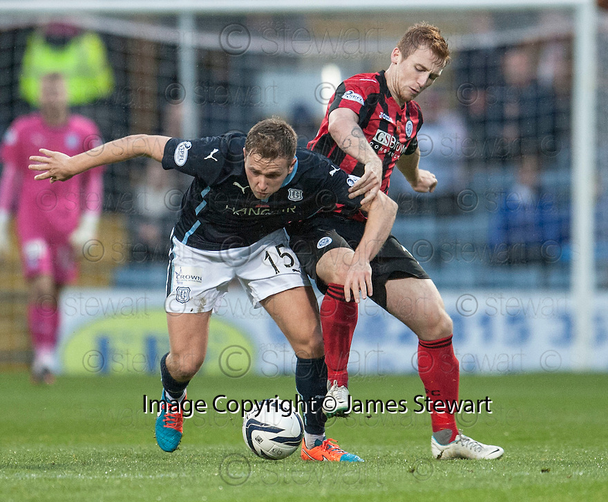 Dundee's Greg Stewart and St Johnstone's Liam Caddis challenge for the ball.