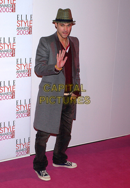 WILL YOUNG.Elle Style Awards 2005,.Spitalfields Market, London, .February 15th 2005..full length green hat grey coat trainers waving.Ref: PL.www.capitalpictures.com.sales@capitalpictures.com.©Capital Pictures.
