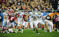 Jan. 1, 2011; Glendale, AZ, USA; Connecticut Huskies tailback (44) Robbie Frey runs for a touchdown against the Oklahoma Sooners in the 2011 Fiesta Bowl at University of Phoenix Stadium. The Sooners defeated the Huskies 48-20. Mandatory Credit: Mark J. Rebilas-