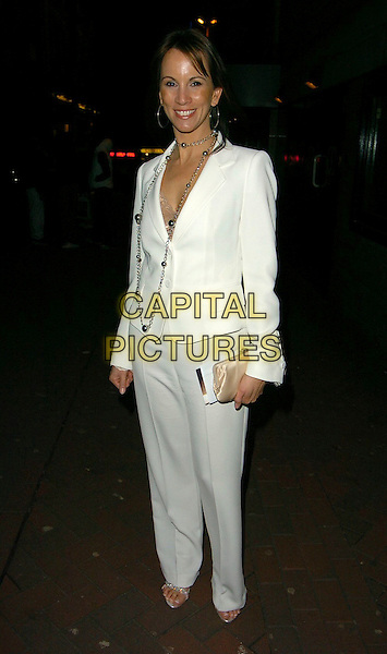 """ALEX KINGSTON.""""Basic Instinct 2: Risk Addiction"""" world film premiere at Vue Leicester Square, London, UK..March 15th, 2006.Ref: CAN.full length white suit jacket trousers cream clutch purse.www.capitalpictures.com.sales@capitalpictures.com.©Capital Pictures"""