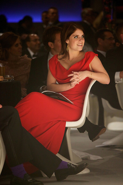 Princess Eugenie wearing Vivienne Westwood listens to speeches at Elton John's White Tie and Tiara Ball