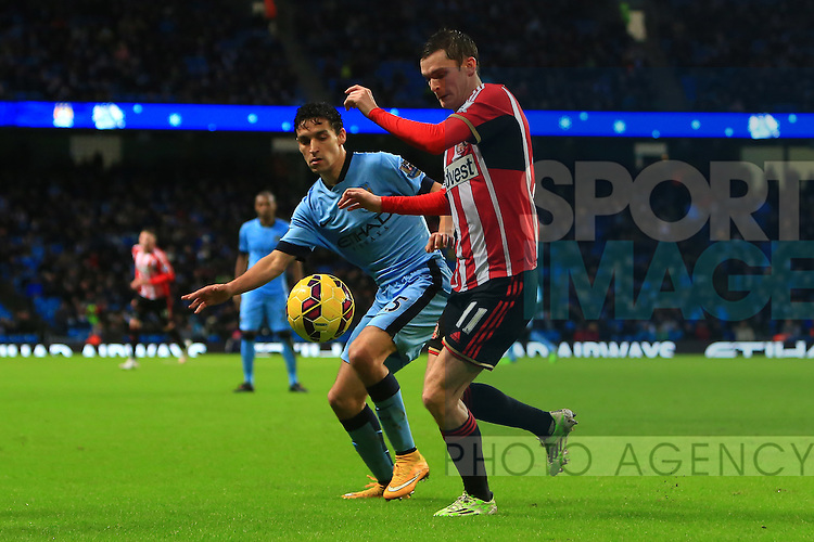Jesus Navas of Manchester City and Adam Johnson of Sunderland battle - Manchester City vs. Sunderland - Barclay's Premier League - Etihad Stadium - Manchester - 28/12/2014 Pic Philip Oldham/Sportimage