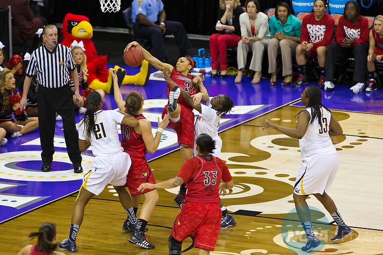 07 APR 2013:  Louisville's Bria Smith (21) pulls in a rebound over California's Eliza Pierre (4) during the national semi-final game between the Louisville Cardinals and the University of California Golden Bears at the Division I Women's Basketball Championship in New Orleans, LA.  The Cardinals defeated The Golden Bears 64-57 to advance to the finals. Matt Marriott/NCAA Photos