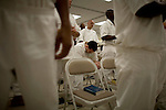 Inmates attend afternoon services at the prison chapel  at the carol s. vance prison in sugarland, texas.  the carol s. vance unit is one of the handful of prisons in the USA managed by evangelical christian pastors who use a bible-centered program for rehabilitation and counseling.  from daybreak to lights out, the prisoners are put through a series of spiritual and religious exercises, lectures, discussion groups asked to bring christ back into their life.  the program is also the prisoner's principal if not the only support chain once they leave the prison and return to society.