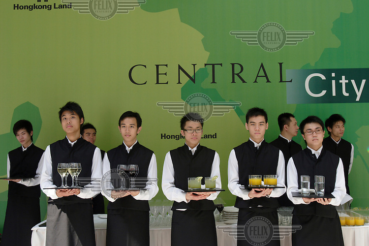 Waiters with a selection of drinks at a press conference in Hong Kong.