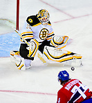 24 September 2009: Boston Bruins' goaltender Tim Thomas makes a save during the first period against the Montreal Canadiens at the Bell Centre in Montreal, Quebec, Canada. The Bruins edged out the Canadiens in an overtime shootout 2-1 in their pre-season matchup. Mandatory Credit: Ed Wolfstein Photo