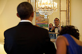 United States President Barack Obama adjusts his tie in the Yellow Oval Room of the White House, following a private reception in honor of President Felipe Calderón of Mexico and his wife, Mrs. Margarita Zavala, Wednesday, May 19, 2010. .Mandatory Credit: Pete Souza - White House via CNP