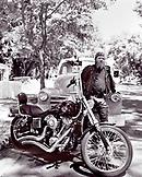 USA, Arizona, biker standing by a motorcycle, Flagstaff (B&W)
