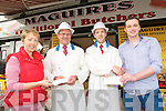 Tom and Liam Maguire of Maguires Butchers Caherslee presenting EUR1000 Holiday voucher each to draw winners Marie O'Connor and Wayne Cahalane of Tralee.