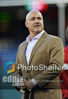 12 October 2012: Washington Nationals General Manager Mike Rizzo watches batting practice prior to Postseason Playoff Game 5 of the National League Divisional Series against the St. Louis Cardinals at Nationals Park in Washington, DC. The Cardinals rallied with four runs in the 9th inning to defeat the Nationals 9-7; winning the NLDS and moving on to the NL Championship Series. Mandatory Credit: Ed Wolfstein Photo