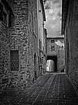 A quiet laneway in the medieval walled town of Panicale in Umbria, Italy.