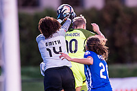 Boston, MA - Saturday April 29, 2017: Breakers goalkeeper Abby Smith (14) blocks ball from Jess Fishlock (10) during a regular season National Women's Soccer League (NWSL) match between the Boston Breakers and Seattle Reign FC at Jordan Field.
