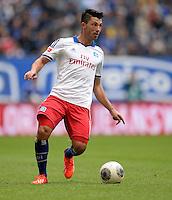 FUSSBALL   1. BUNDESLIGA   SAISON 2013/2014   4. SPIELTAG Hamburger SV - Eintracht Braunschweig                  31.08.2013 Tolgay Arslan (Hamburger SV)  am Ball