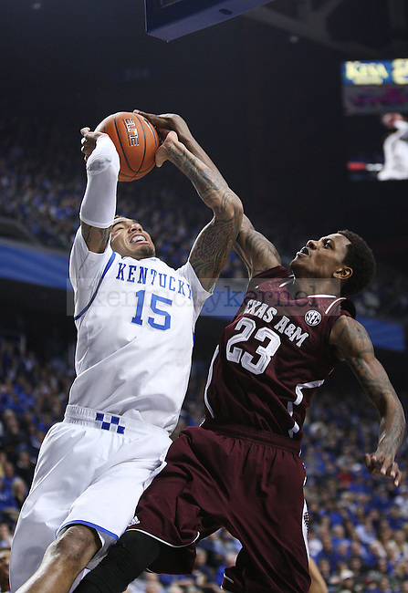 Texas A&M guard Jamal Jones (23) attempts to block Kentucky Wildcats forward Willie Cauley-Stein (15) from scoring a layup during the first half of UK Men's Basketball vs. Texas A&M at Rupp Arena in Lexington, Ky., on Tuesday, January 21, 2014. Photo by Emily Wuetcher | Staff
