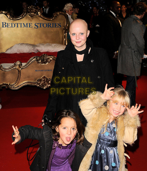 """GAIL PORTER, DAUGHTER HONEY HIPGRAVE & GUEST.Attends the UK Film Premiere of """"Bedtime Stories"""" at the Odeon Kensington, London, England, December 11th 2008..half length black coat scarf fur funny faces hands hand on head tongue sticking out .CAP/CAN.©Can Nguyen/Capital Pictures"""