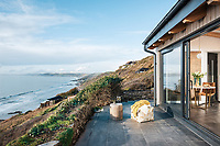 BNPS.co.uk (01202 558833)<br /> Pic: UniqueHomeStays/BNPS<br /> <br /> Pictured: The chalet has amazing ocean views<br /> <br /> A couple who spent £450,000 on turning a 'rotting shed' into an exclusive seaside bolthole hope to recoup their money - by renting it out for £3,150 a week. <br /> <br /> Tracey Gilpin and Peter Burridge went out on a limb when they bought the 60-year-old wooden shack for a whopping £220,000.<br /> <br /> Despite its ramshackle condition, the cabin could command such a hefty asking price as it is located halfway up a cliff with stunning views of Whitsand Bay in Cornwall.<br /> <br /> But in order to make the coastal chalet a viable holiday let the couple had to demolish it and build a new one from scratch.