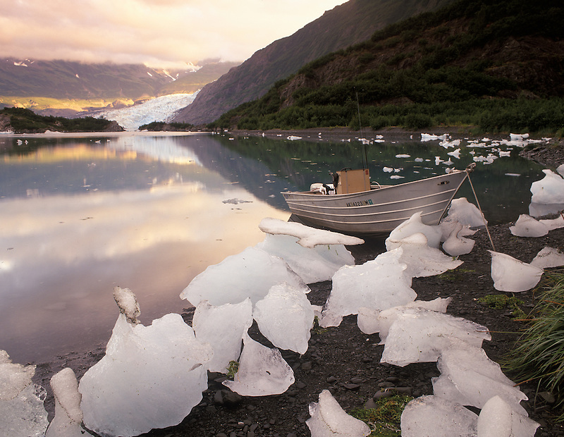 Boat in Shoup bay with glacies and sunrise, Alaska