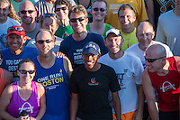 Meb Keflezghi smiles for a photo with more than 200 other runners at the Run with Meb event at Fleet Feet Des Peres, in St. Louis County, MO. Wednesday, September 3, 2014.