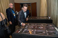 Sam Rockwell signs a poster backstage with the Oscar&reg; for performance by an actor in a supporting role for work on &ldquo;Three Billboards Outside Ebbing, Missouri&rdquo; during the live ABC Telecast of The 90th Oscars&reg; at the Dolby&reg; Theatre in Hollywood, CA on Sunday, March 4, 2018.<br /> *Editorial Use Only*<br /> CAP/PLF/AMPAS<br /> Supplied by Capital Pictures