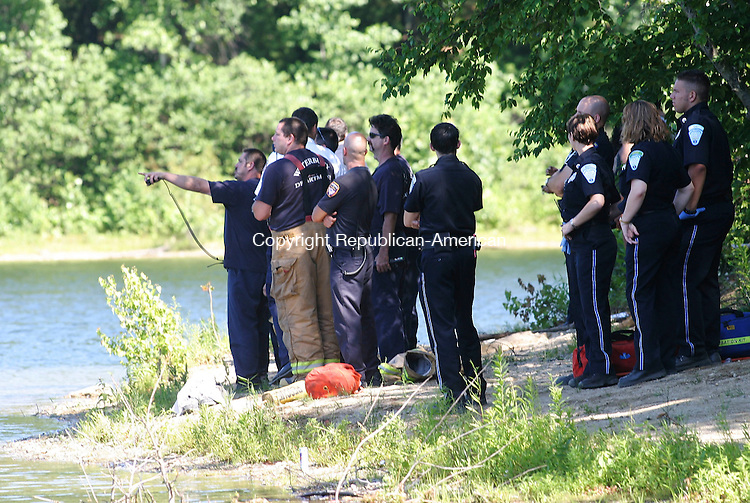 WATERBURY, CT 04 July 2005 -070405BZ01- Waterbury Police, Waterbury firefighters and emergency medical personnel watch from shore as Waterbury firefighters in a boat search for the body of a 42-year-old Waterbury man who drowned in East Mountain Reservoir Monday afternoon.<br /> Jamison C. Bazinet Photo
