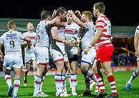 Picture by Allan McKenzie/SWpix.com - 17/04/2015 - Rugby League - Ladbrokes Challenge Cup - Wakefield Trinity Wildcats v Halifax RLFC - Rapid Solicitors Stadium, Wakefield, England - Wakefield's Ian Kirke is congratulated by team mates on scoring.