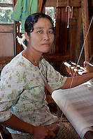 Myanmar, Burma.  Burmese Weaver Working at her Loom, Inle Lake, Shan State.