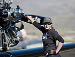 Kaitlyn Cardin helps out with the Six-Cat plane during the National Championship Air Races at the Reno-Stead Airfield Friday, Sept. 18, 2015.