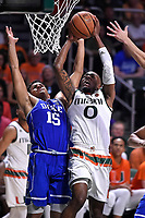 CORAL GABLES, FL - FEBRUARY 25:  Miami guard Ja'Quan Newton (0) puts up a basket in the second half despite the efforts of Duke guard Frank Jackson (15) as the University of Miami Hurricanes defeated the Duke University Blue Devils, 55-50, on February 25, 2017, at the Watsco Center in Coral Gables, Florida. (Photo by Samuel Lewis/Icon Sportswire)