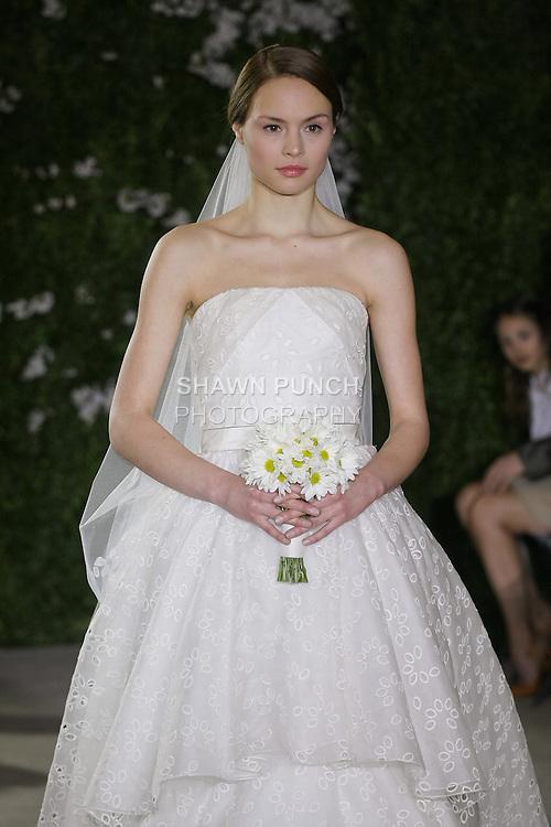 Model walks runway in an Anastasia wedding dresses by Carolina Herrera, for the Carolina Herrera Bridal Spring 2012 runway show.