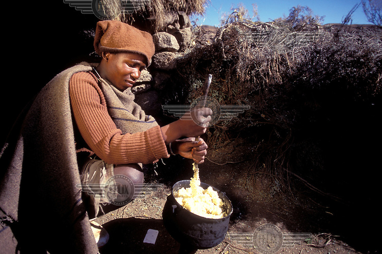 © Giacomo Pirozzi / Panos Pictures..LESOTHO..Rural man preparing food.
