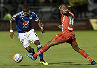 TUNJA -COLOMBIA, 29-07-2018. Miller Mosquera (Der) jugador de Patriotas Boyacá disputa el balón con Andres Felipe Roman (Izq) jugador de Millonarios durante partido por la fecha 2 de la Liga Águila II 2018 realizado en el estadio La Independencia en Tunja. / Miller Mosquera (R) player of Patriotas Boyaca fights for the ball with Andres Felipe Roman (L) player of Millonarios during match for the date 2 of Aguila League II 2018 at La Independencia stadium in Tunja. Photo: VizzorImage/ Gabriel Aponte / Staff