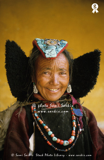 Senior Tibetan woman in traditional clothing, smiling, portrait (Licence this image exclusively with Getty: http://www.gettyimages.com/detail/200555830-001 )
