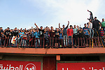 Palestinian fans attend a a football match between Palestinian Shabab Rafah football club players (in blue) and Shejaiya's football club players (in green) at Palestine Stadium in Gaza city on March 4, 2018. Photo by Mahmoud Ajour