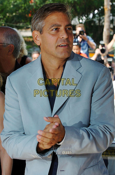 "GEORGE CLOONEY.62nd Venice Film Festival.Photocall for ""Good Night, and Good Luck"".September 1st, 2005.Ref: OME.half length grey gray suit jacket hands together.www.capitalpictures.com.sales@capitalpictures.com.© Capital Pictures."