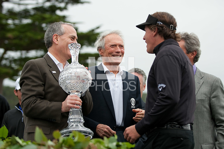 PEBBLE BEACH, CA--Phil Mickelson celebrates his win  with Clint Eastwood at the AT&T Pebble Beach National Pro-Am Golf Championship at Pebble Beach Golf Links in Pebble Beach, CA on Sunday, February 12, 2012. Mickelson won the tournament with a total score of 269.