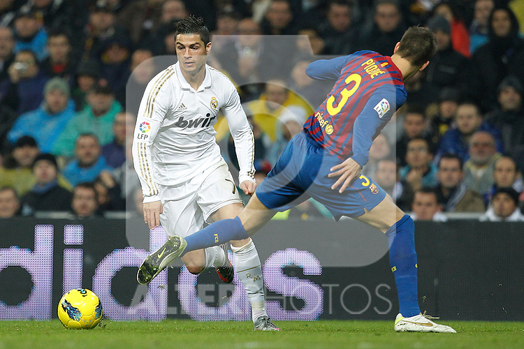Real Madrid's Cristiano Ronaldo and FC Barcelona's Gerard Pique during Spanish  League match on december 10th, 2011..Photo: Alex Cid-Fuentes / ALFAQUI