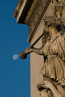 Arc de Triomphe, Paris.  Detail of Trumpeter in Cortot's The Triumph of Napoleonsculpture on the Champs Elysee side of the Arc.  Early morning shot with moon positioned near end of trumpet.  July 2008
