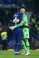 Antonio Rudiger and Willy Caballero embrace each other at the final whistle as they celebrate Chelsea's victory during Chelsea vs Malmo FF, UEFA Europa League Football at Stamford Bridge on 21st February 2019