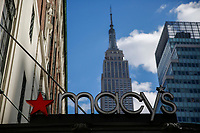 NEW YORK, NY - FEBRUARY 25:  The Macy's headquarter logo is pictured as the Empire State Building is seen at the background on February 25, 2019 in Manhattan, New York. Earnings reports of $2.53 is expected for Macy's Inc. with a share on sales of $8.4 billion before the market opens Feb. 26,.  (Photo by Eduardo Munoz Alvarez/VIEWpress)