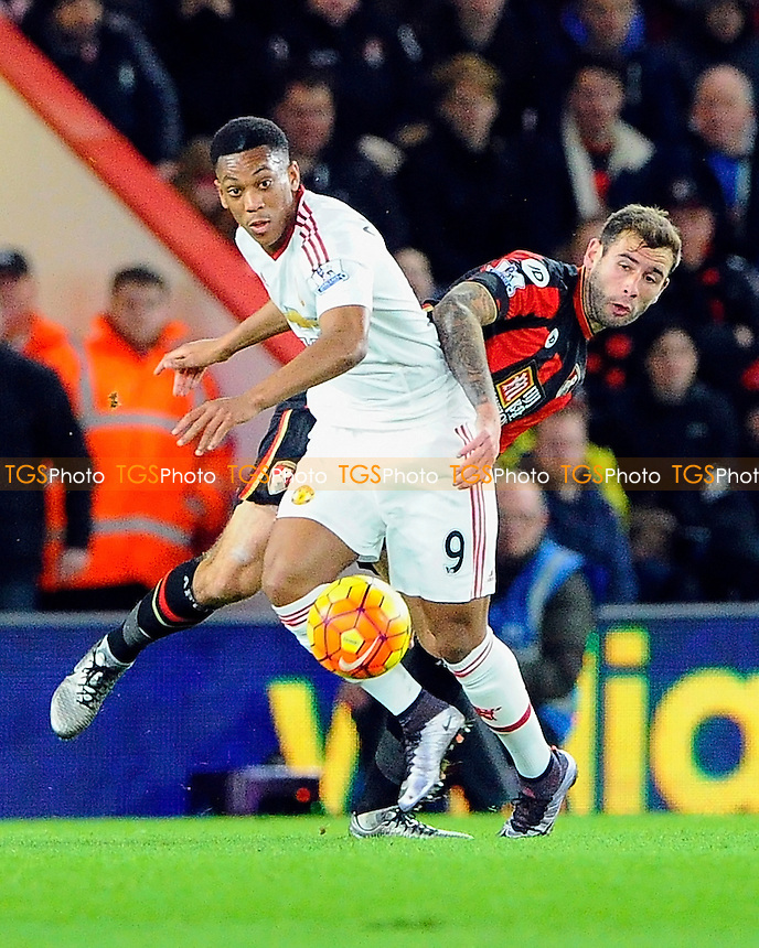 Steve Cook of AFC Bournemouth vies for the ball with Anthony Martial of Manchester United during AFC Bournemouth vs Manchester United at the Vitality Stadium