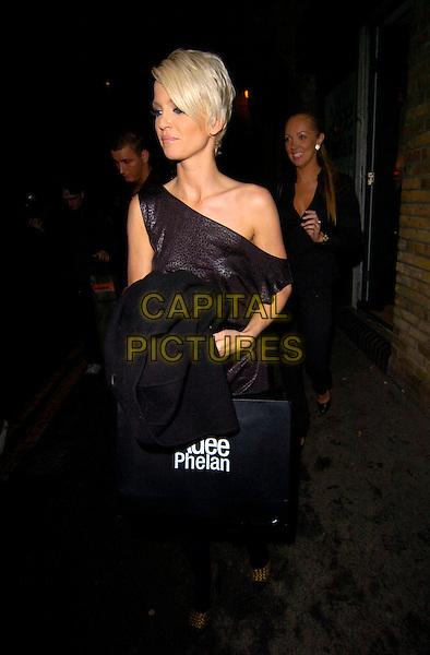 SARAH HARDING.At the Adee Phelan Hairdressing Salon Launch, Covent Garden, London, England..November 27th 2007.full length black one shoulder dress bronze shoes tights goody bag.CAP/CAN.©Can Nguyen/Capital Pictures