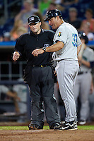 Cedar Rapids Kernels manager Jamie Burke #33 argues a call with home plate umpire Mike Huss during a game against the Quad Cities River Bandits at Modern Woodmen Park on June 30, 2012 in Davenport, Illinois.  Quad Cities defeated Davenport 8-7.  (Mike Janes/Four Seam Images)