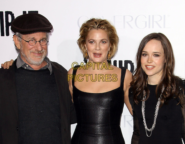 "STEVEN SPEILBERG, DREW BARRYMORE & ELLEN PAGE .Attending the ""Whip It"" Los Angeles Premiere held At Grauman's Chinese Theatre, Hollywood, California, USA, 29th September 2009..half  length black dress shiny leather cap hat silver necklace hair up glasses beard facial hair director .CAP/ADM/KB.©Kevan Brooks/AdMedia/Capital Pictures."