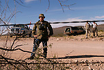 A Minuteman Project volunteer monitors the US/Mexico border fence near Naco, Mexico on Saturday, April 2, 2005. The Minuteman Project is an all-volunteer group monitoring the US/Mexico border in Arizona for the month of April, reporting all illegal border crossers to the US Border Patrol.<br />