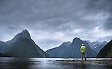 NEW ZEALAND, Fiordland National Park, Man Admiring Milford Sound, Ben M Thomas