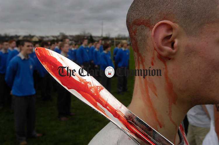 "James Fahy as a bloodied militia man in the Gort Community School re-enactment of a genocide as part of the Transition Year's project ""R2R or not 2P"". Photograph by John Kelly."