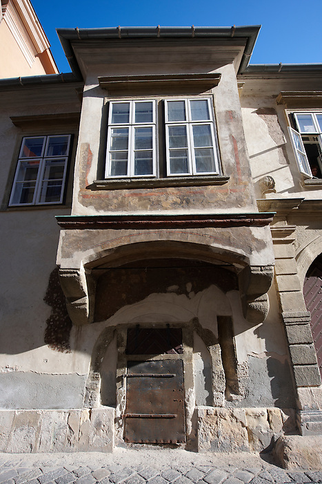 17th century town house with 16th century enclosed balcony  and 14th century ground floor windows- Sopron, Hungary