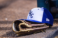 An Oklahoma City Dodgers hat and glove sit on the dugout steps during a game against the Nashville Sounds at Chickasaw Bricktown Ballpark on April 15, 2015 in Oklahoma City, Oklahoma. Oklahoma City won 6-5. (William Purnell/Four Seam Images)